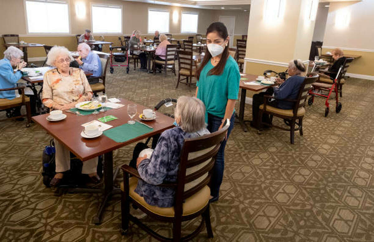 Residents talk with a caregiver in the dining room of a nursing home. The Illinois Department of Public Health performs annual inspections at those facilities, and those inspections sometimes result in fines when violations are found. But fines can also be levied as the result of a complaint against a facility if an investigation by the IDPH discovers there were indeed violations.