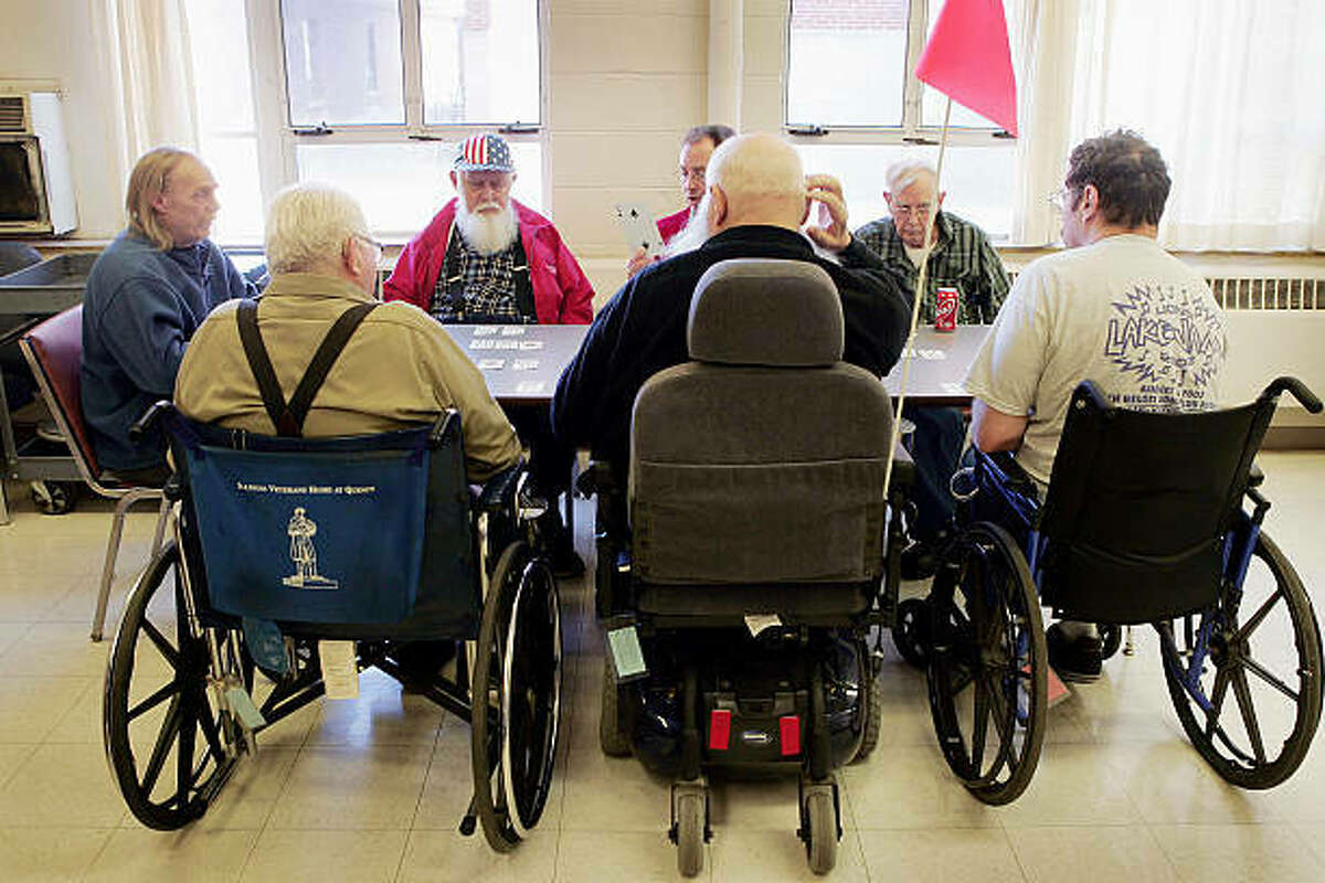 Veterans gather for a game of cards at a nursing home. The Illinois Department of Public Health performs annual inspections at those facilities, and those inspections sometimes result in fines when violations are found. But fines can also be levied as the result of a complaint against a facility if an investigation by the IDPH discovers there were indeed violations.