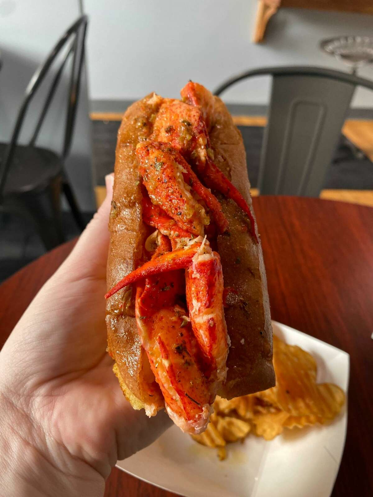 The Heat Wave lobster roll, shown at LobsterCraft's West Hartford restaurant, has just the right amount of tongue-tingling spice from pepper-infused butter.