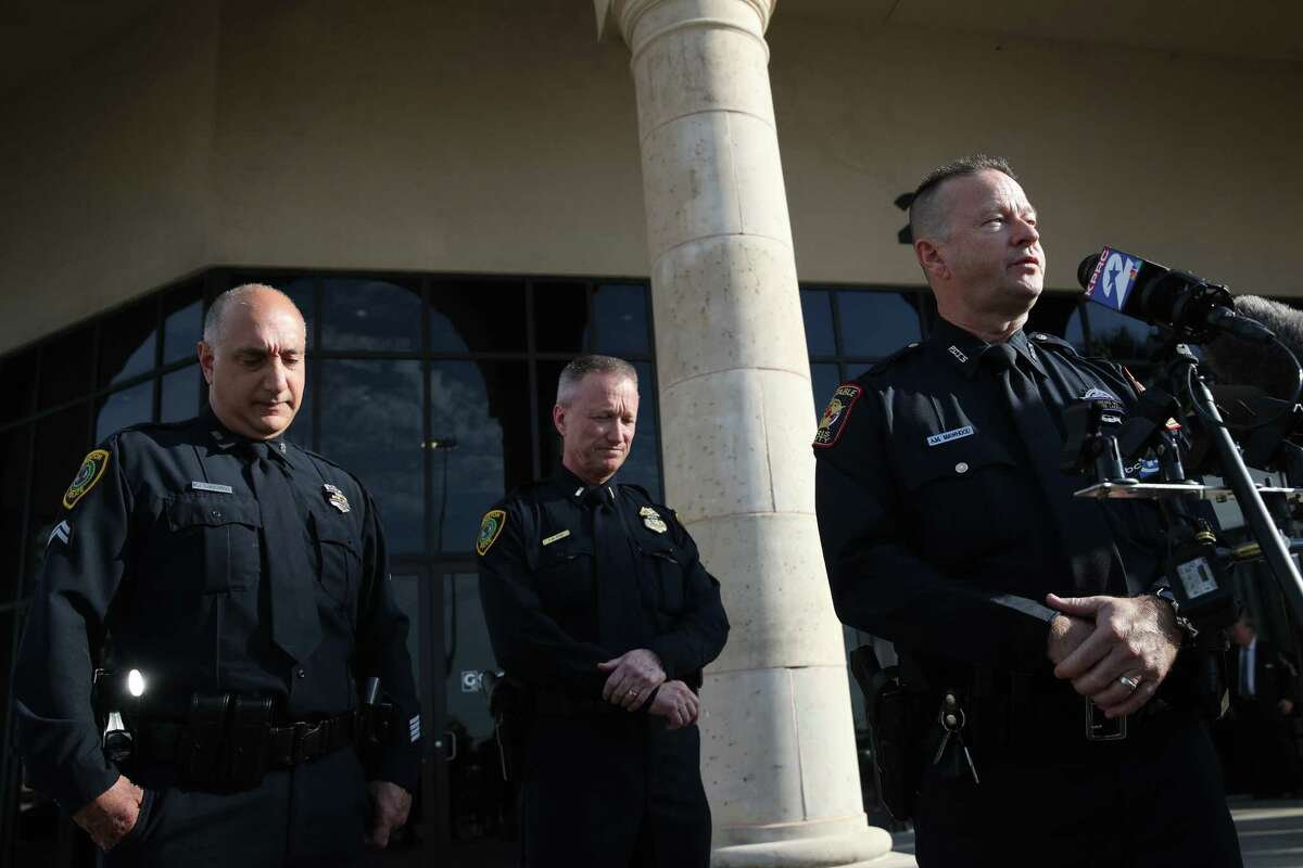 """Harris County Pct. 5 Deputy Constable Anton Mawhood, right, talks about his former coworker, Houston Police Department Senior Police Officer William """"Bill"""" Jeffrey as HPD Lt. Thomas Spjut, center, and HPD officer M.J. Lombardo, left, listen as they speak to reporters before funeral services for Jeffrey on Monday, Sept. 27, 2021, at Grace Church Houston in Houston."""
