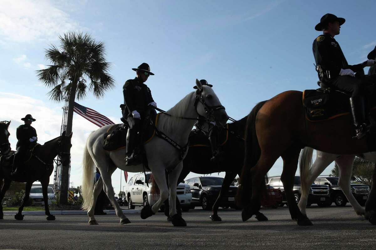 """Mounted Houston Police officers prepare for funeral services for Senior Police Officer William """"Bill"""" Jeffrey on Monday, Sept. 27, 2021, at Grace Church Houston in Houston."""