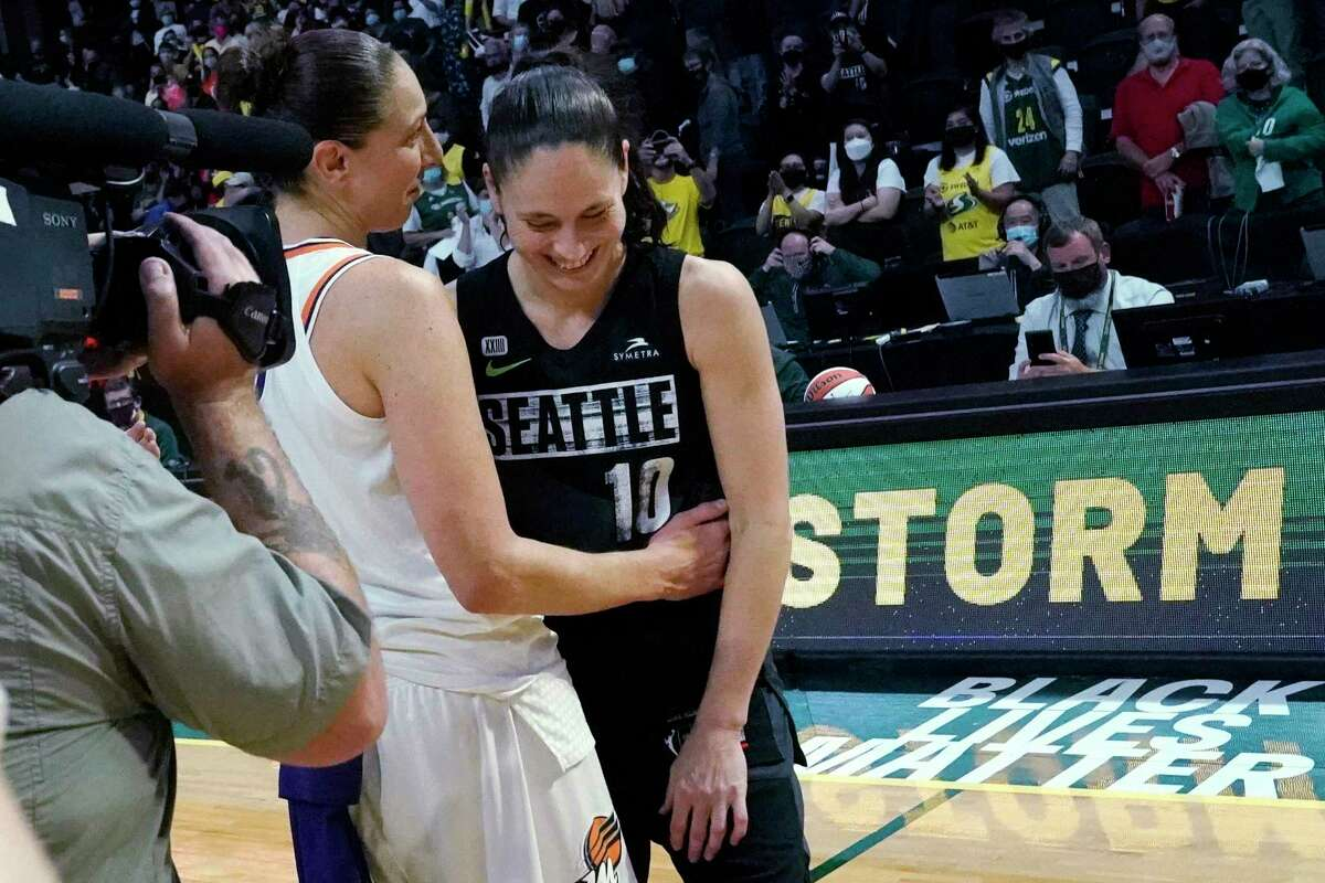 Seattle Storm's Sue Bird, right, is greeted by Phoenix Mercury's Diana Taurasi after their second round WNBA basketball playoff game Sunday, Sept. 26, 2021, in Everett, Wash. Phoenix won in overtime 85-80. (AP Photo/Elaine Thompson)