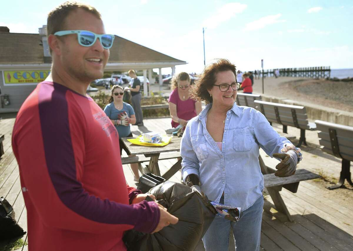Tor Blackstad, of Milford, and State Rep. Kathy Kennedy participate in a beach clean-up at Gulf Beach in Milford, Conn. on Sunday, September 26, 20i21.