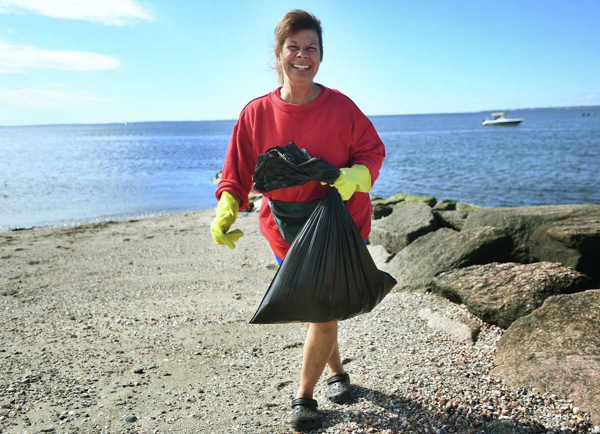 Jane Capua, of Milford, participates in a beach clean-up, organized by State Rep. Kathy Kennedy, at Gulf Beach in Milford, Conn. on Sunday, September 26, 20i21.