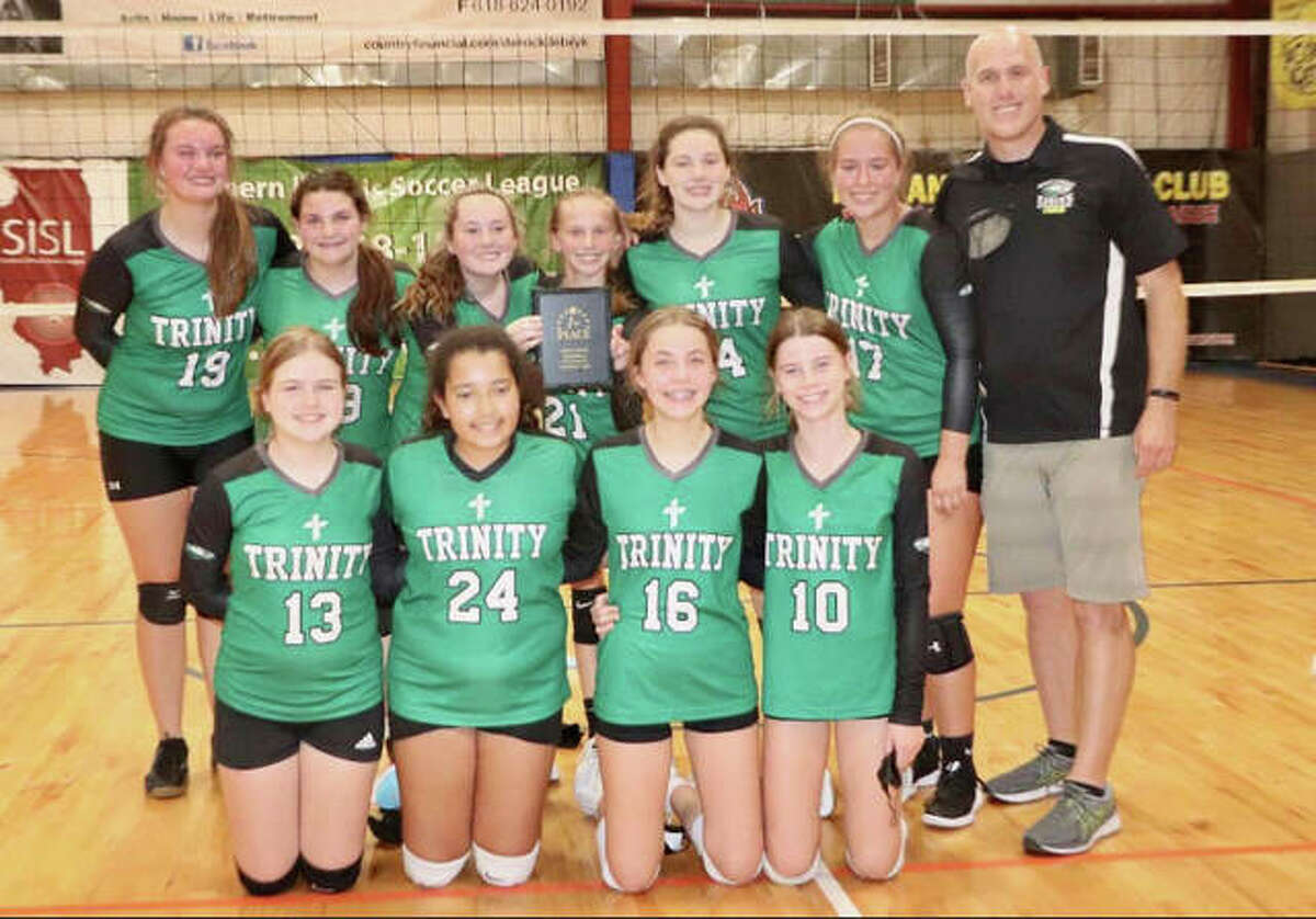 The Trinity girls volleyball team recently placed first at the 12-team Holly Reeb Memorial Volleyball Tournament in Belleville. Pictured in the front row from left to right are Isla Hurtle, Tahlea Heard, Annika Jenkins and Avery Johnson. In the back row are Avery Simaytis, Emma Gusewelle, Alyssa Niemann, Sarah Haislar, Lainey McFarlin, Avery Wampler and coach Beau McFarlin.