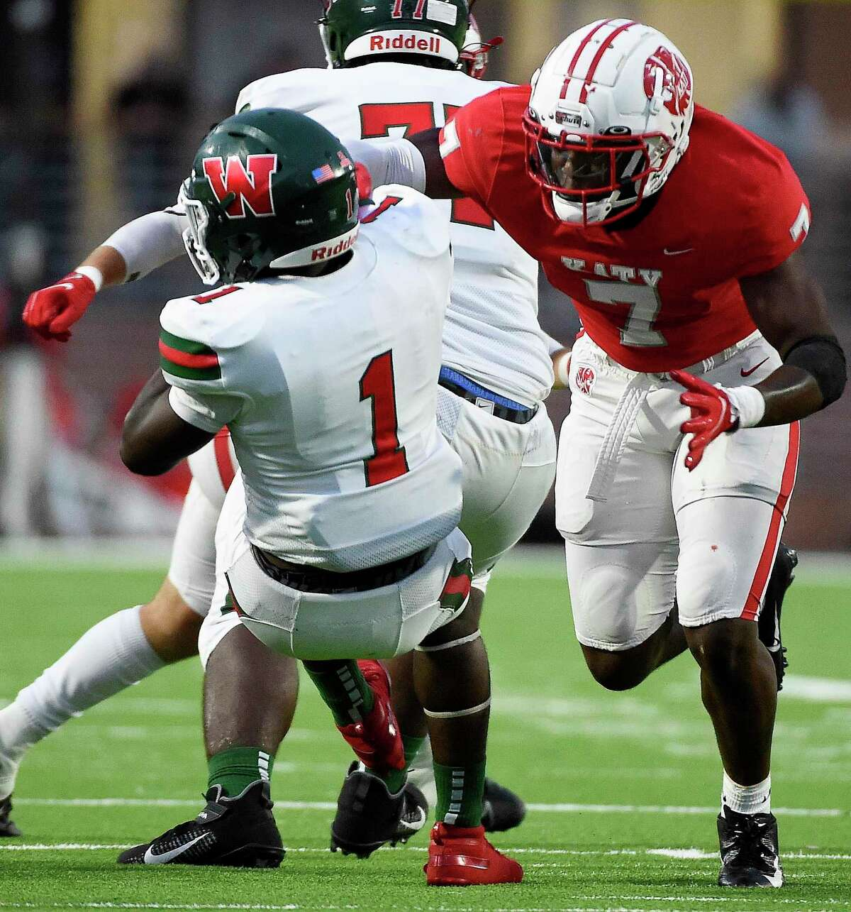 Katy defensive back Johnathan Hall (7) tacles The Woodlands running back JoBarre Reed for a loss during the first half of a high school football game, Thursday, Sept. 16, 2021, in Katy.