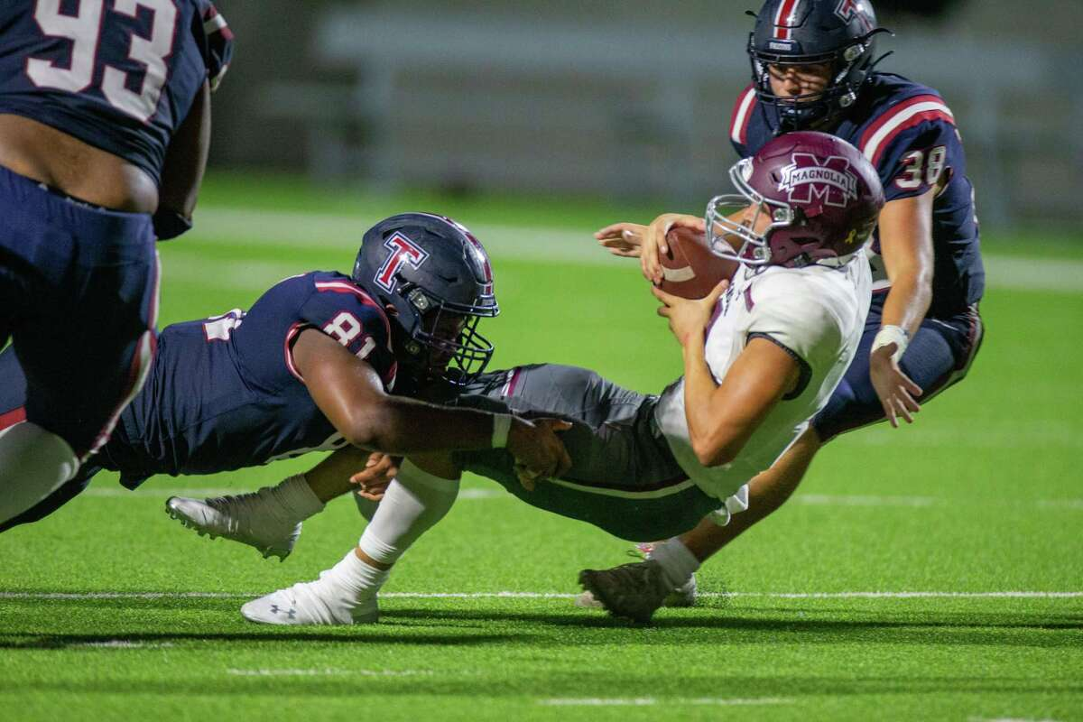 Magnolia Bulldogs QB Ross Choate (2) is stopped by Tompkins Falcons DL Sean Dubose (81) during second half of action between Tompkins Falcons vs. Magnolia Bulldogs during a high school football game at the Legacy Stadium, Saturday, August 28, 2021, in Katy. Tompskins Falcons defeated Magnolia Bulldogs 18-6. (Juan DeLeon/Contributor)
