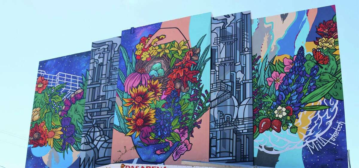 Mila Sketch's mural on the Pasadena Gun Center building overlooks construction that is part of the Shaw Avenue revitalization project in Pasadena. The project is upgrading the roadway, lighting, drainage and sidewalks and is providing landscaping and seven murals.