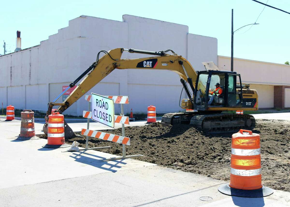 An excavator digs at the corner of Shaw and Spencer as part of the Shaw Avenue project.