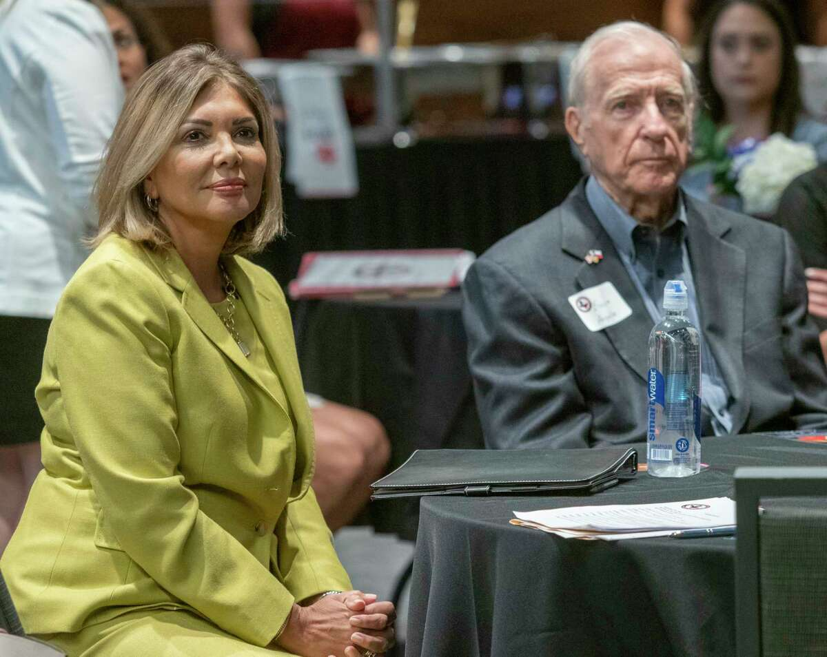 Eva Guzman, former Texas Supreme Court Judge, and currently running for Texas Attorney General, sits with former Midland Mayor Ernie Angelo before speaking 09/27/2021 during the Republican National Hispanic Assembly luncheon at the Bush Convention Center. Tim Fischer/Reporter-Telegram