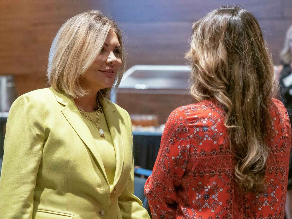 Eva Guzman, former Texas Supreme Court Judge, and currently running for Texas Attorney General, talks with Bella Cross before speaking 09/27/2021 during the Republican National Hispanic Assembly luncheon at the Bush Convention Center. Tim Fischer/Reporter-Telegram