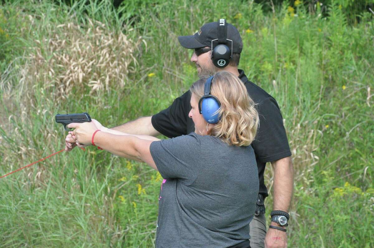 Kevin Brown of Randy's Hunting Center offers advice to a woman participating in a 'Ladies Night' shooting event at Thumb Sportsman's Club gun range in Bad Axe. Randy's and the club are hosting another event on Wednesday. Sept. 29, at 5:30 p.m., with an optional safety lesson starting at 5 p.m. (Courtesy Photo)