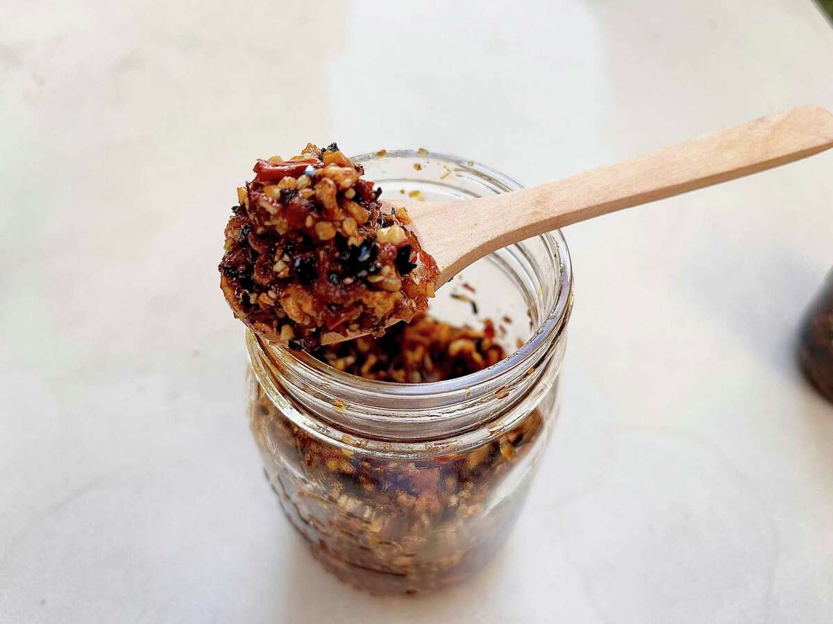 The spicy chile crisp recipe from Serious Eats includes a variety of dried chiles, fresh ginger, star anise, shallots, garlic, crushed peanuts, and Sichuan peppercorns.