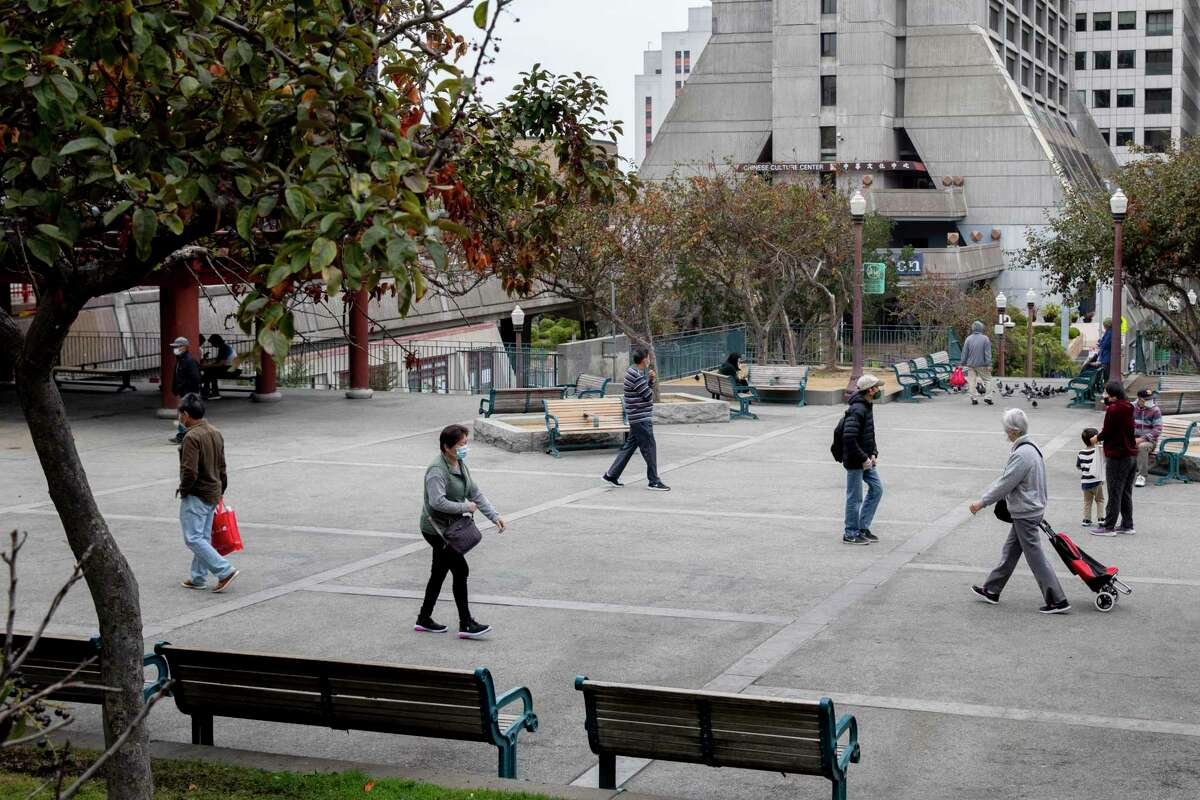 People walk through the main area of Portsmouth Square in San Francisco.