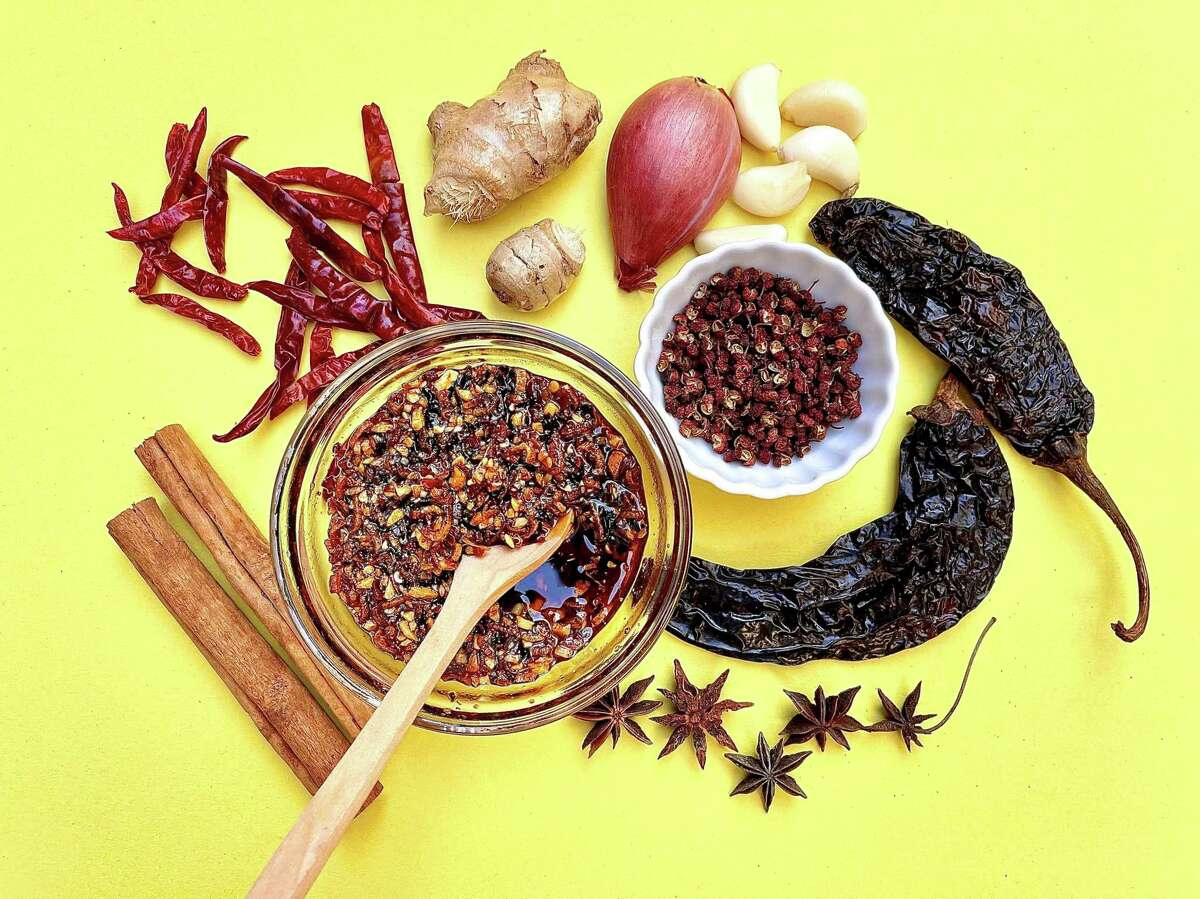 Chile crisp, or sometimes called chili crunch, is made with crushed and ground dried chile pods, Sichuan peppercorns, fried shallots and garlic, sesame seeds or chopped peanuts, and spices steeped in a neutral oil.