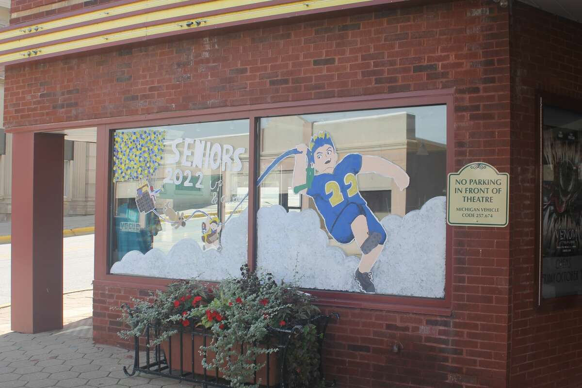 Manistee High School's senior class painted the windows of the Vogue Theatre as part of the school's homecoming week festivities.