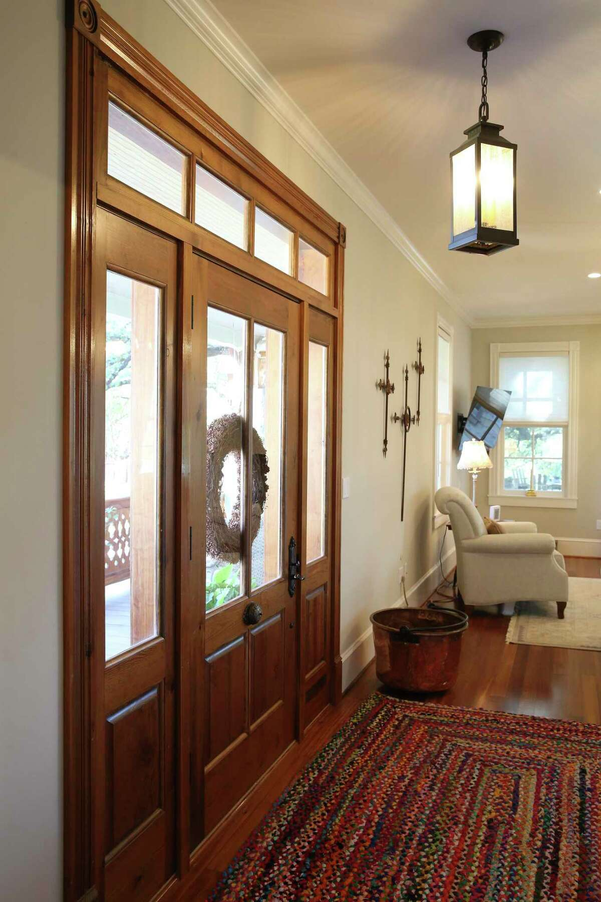 The front door, trim and flooring are made from reclaimed longleaf pine.