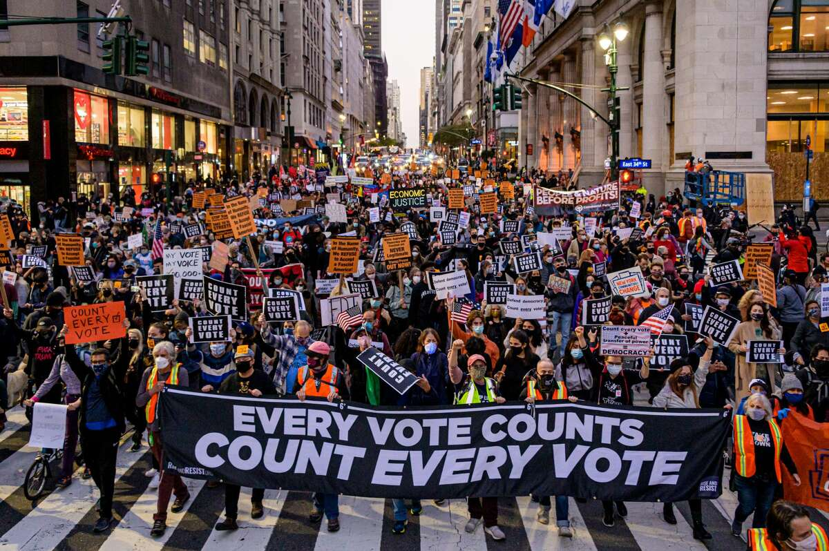 """Pictured is Manhattan, New York. Participants holding a banner reading: """"EVERY VOTE COUNTS/COUNT EVERY VOTE"""" at a protest in 2020."""