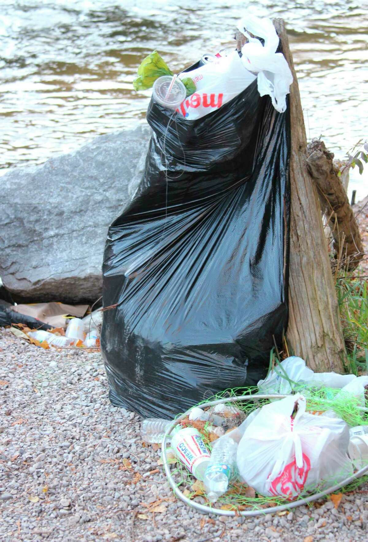 Garbage left at the Homestead Dam after the 2020 salmon run was a common sight as the river there is popular with anglers. The DNR is reminding anglers to clean up after themselves. (File Photo)