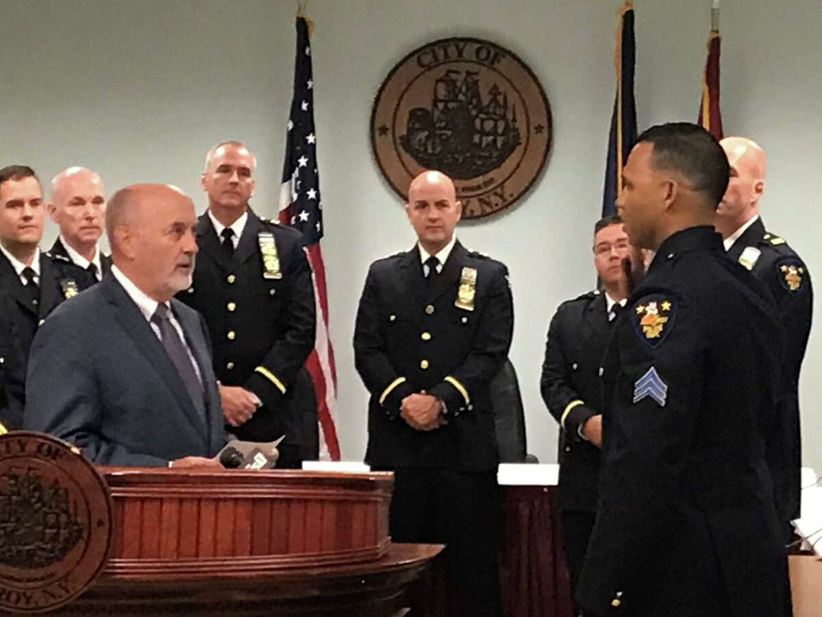 Mayor Patrick Madden released his proposed budget for fiscal year 2022. Pictured, Madden swears in Sgt. Anthony Conyers as the city police force's newest and first Black police captain on Monday Sept. 27, 2021 at Troy City Hall, Troy, N.Y. as members of the police department's command staff watch.