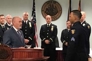 Mayor Patrick Madden swears in Sgt. Anthony Conyers as the city police force's newest and first Black police captain on Monday Sept. 27, 2021 at Troy City Hall, Troy, N.Y. as members of the police department's command staff watch.
