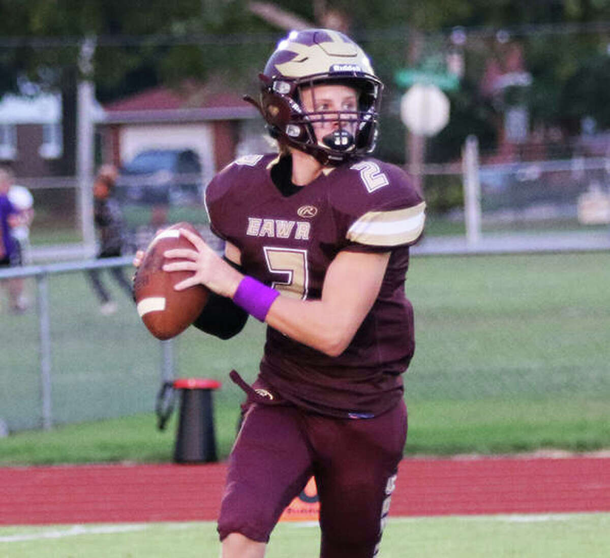 EA-WR quarterback Chase Keshner rolls out and looks for a receiver during a Sept. 3 game against CM at Memorial Stadium in Wood River. The Oilers' loss at home on Friday to Breese Central was their fourth in a row.