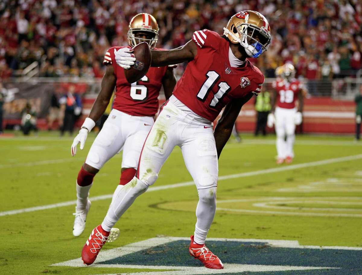 SANTA CLARA, CALIFORNIA - SEPTEMBER 26: Brandon Aiyuk #11 of the San Francisco 49ers celebrates after catching a touchdown pass during the third quarter against the Green Bay Packers in the game at Levi's Stadium on September 26, 2021 in Santa Clara, California. (Photo by Thearon W. Henderson/Getty Images)