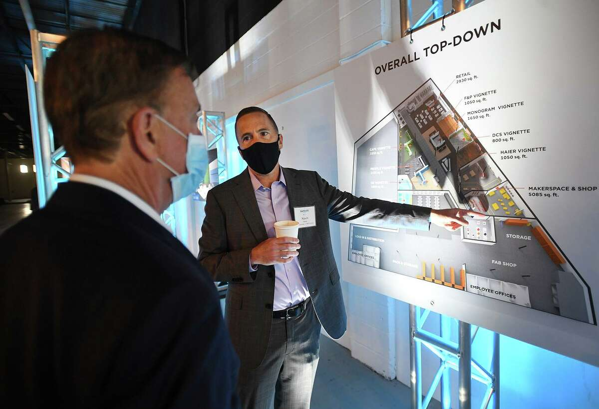 Gov. Ned Lamont, left, and GE Appliances CEO and President Kevin Nolan discuss the company's new CoCREATE production center at 49 John St., in Stamford, Conn. on Monday, Sept. 27, 2021.