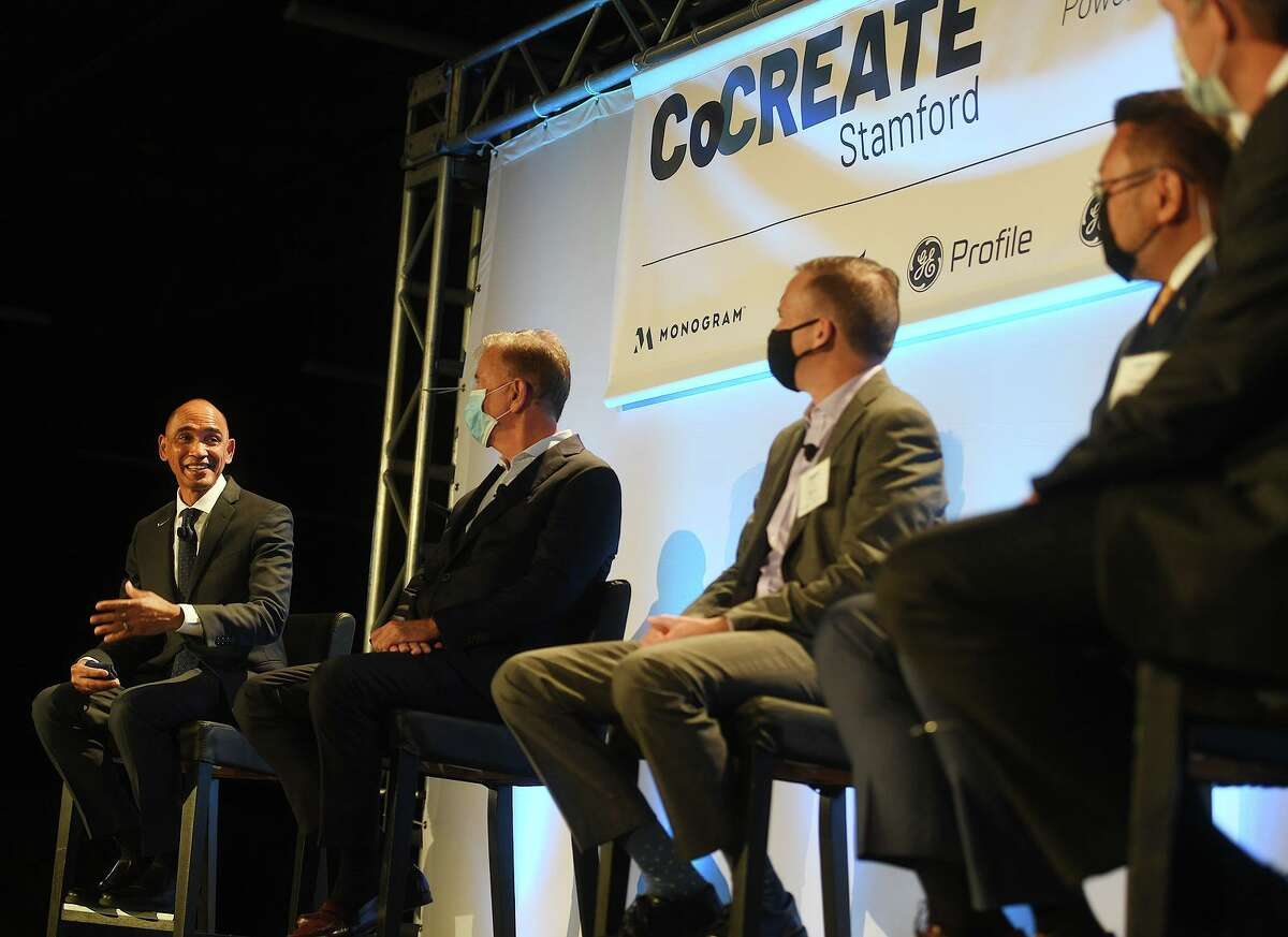From left; University of Connecticut interim President Dr. Andrew Agwunobi; Gov. Ned Lamont; GE Appliances CEO and President Kevin Nolan; Connecticut State Colleges and Universities President Terrence Cheng and AdvanceCT CEO and President Peter Denious participate in a panel discussion at GE Appliances' new CoCREATE production center at 49 John St., in Stamford, Conn.