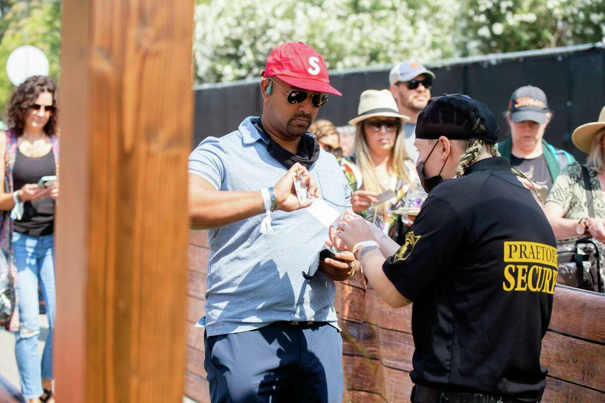 Security checks an attendee's vaccination card at BottleRock.