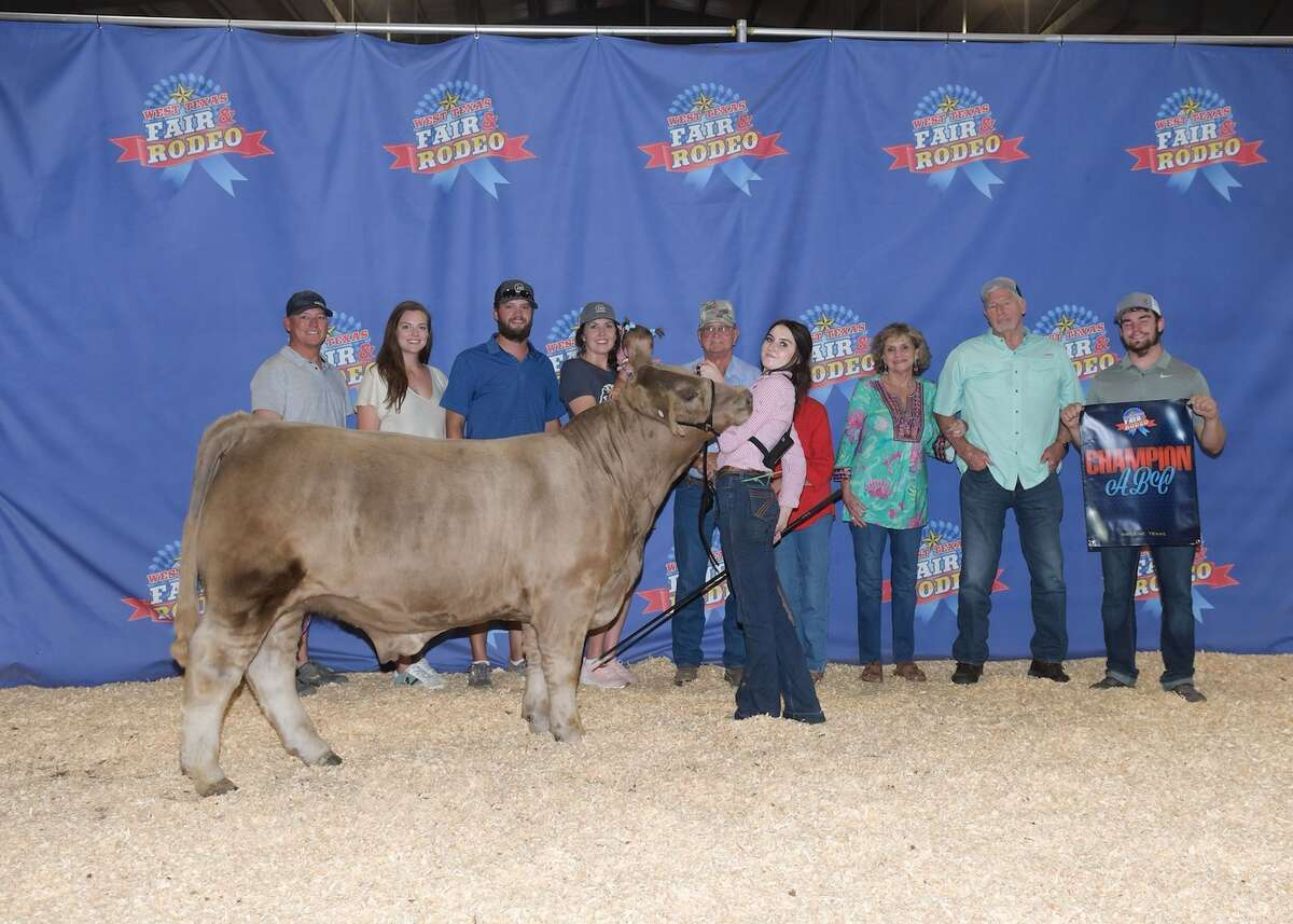 Cassie Jo Bennett stand with her champion steer and her family at the West Texas Fair in Abilene. Pictured are (from left to right) Rusty Bennett,Taylor and Clay Morrison, Heather Bennett, Donald and Thelma Seltzer, Darla and Chip Bennett and Colt Bennett. Cassie Jo is standing with the champion of the ABC breed.