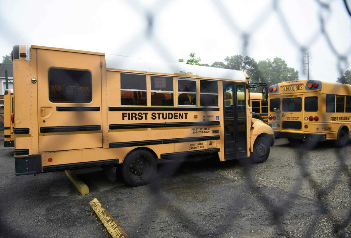 Buses are parked at the First Student bus depot in Stamford, Conn. Thursday, June 20, 2019.