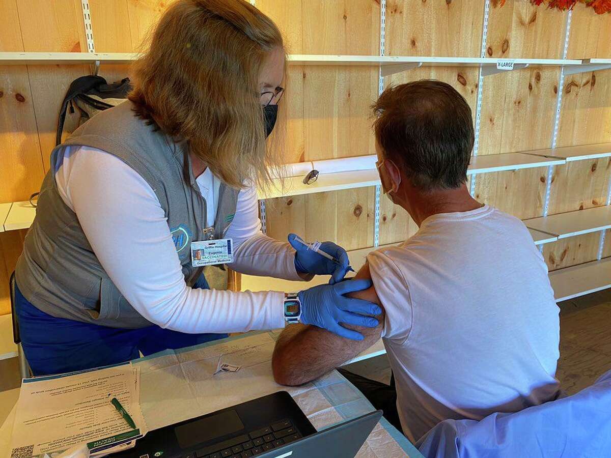 Gov. Ned Lamont receiving a COVID-19 vaccine booster shot at the Durham Fair on Saturday, Sept. 25.