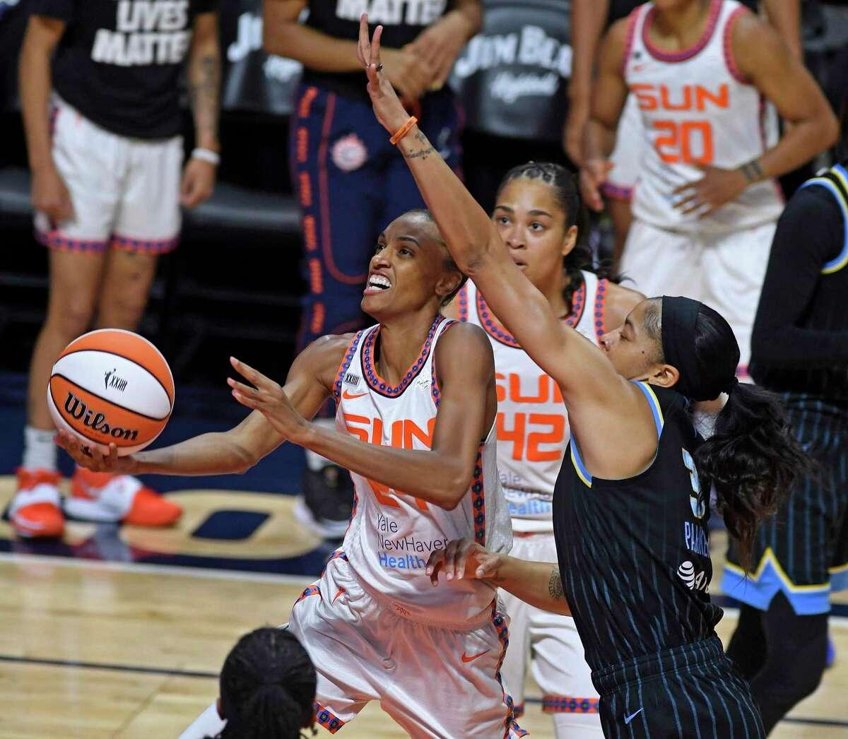 Connecticut Sun forward DeWanna Bonner, left, drives past the defense of Chicago Sky forward Candace Parker during a WNBA basketball game Sunday, June 27, 2021, in Uncasville, Conn. (Sean D. Elliot/The Day via AP)