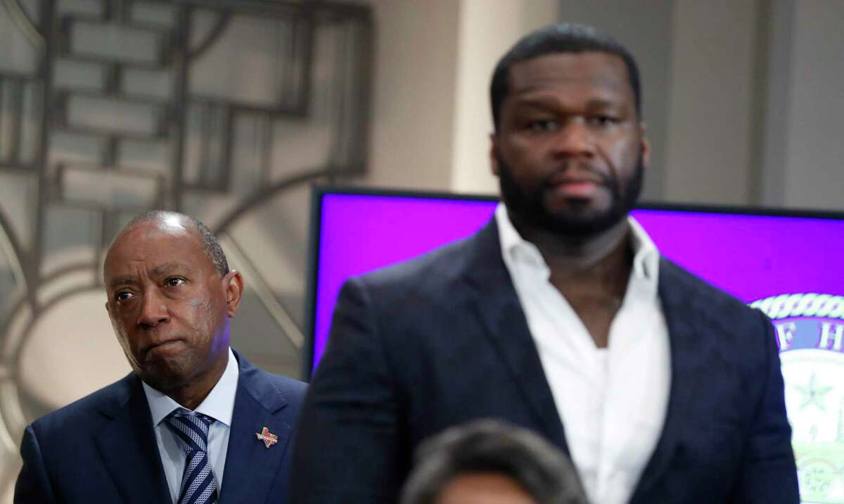 """Mayor Sylvester Turner stands behind Curtis """"50 Cent"""" Jackson, who along with his G-Unity Foundation, announced a program to equip students from three Houston ISD high schools with critical skills at City Hall's Legacy Room, Monday, May 17, 2021, in Houston."""