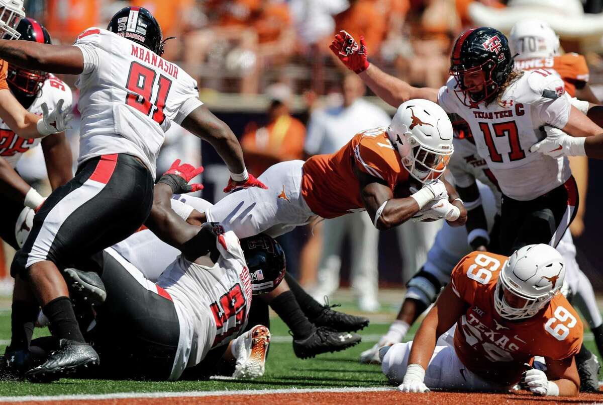 Keilan Robinson scores in the fourth quarter against Texas Tech thanks to the Longhorns' offensive line clearing the way.