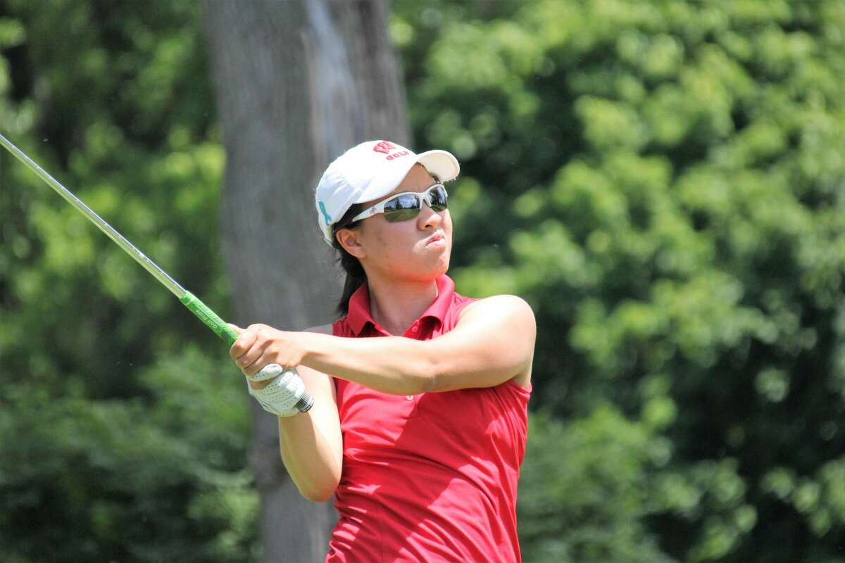 Kim Dinh watches her shot during the 2020 GAM Women's Mid-Amateur in Lansing.
