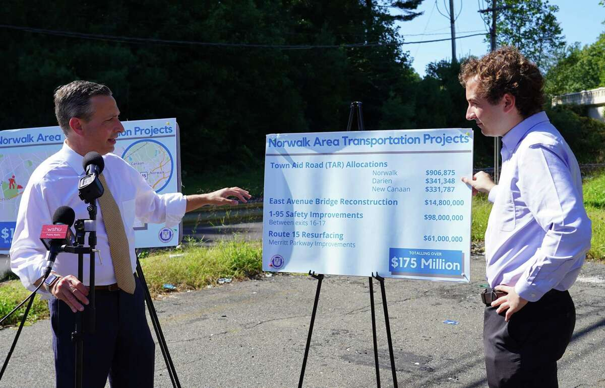 State senators Bob Duff, left, and Will Haskell held a press conference in a commuter lot near Exit 38 of the Merritt Parkway in New Canaan to discuss $175 million in funding for infrastructure.