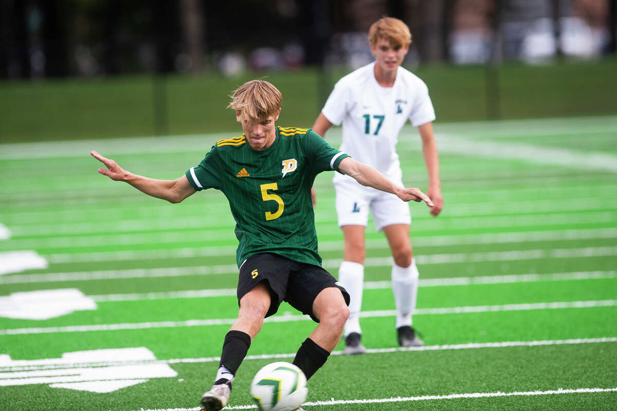 Dow High's Ian Metzler plays the ball during a Sept. 13, 2021 game against Lapeer.