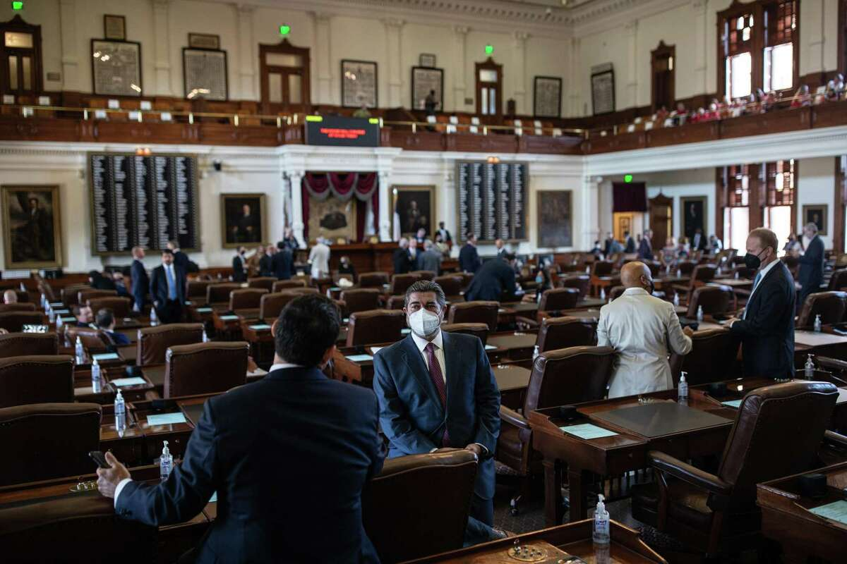 Texas state representatives gather in the House chamber before the start of the 87th Legislature's third special session at the State Capitol on September 20, 2021 in Austin, Texas. (Photo by Tamir Kalifa/Getty Images)