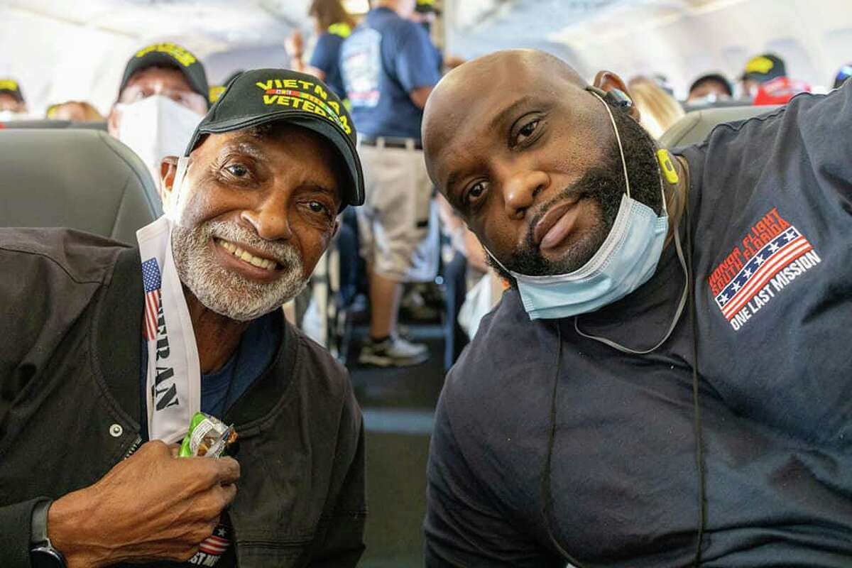 Charles James, left, and his son, C.J., participate in the South Florida Honor Flight program on Sept. 12. James, a Conroe native and Vietnam veteran, now lives in the Miami area.