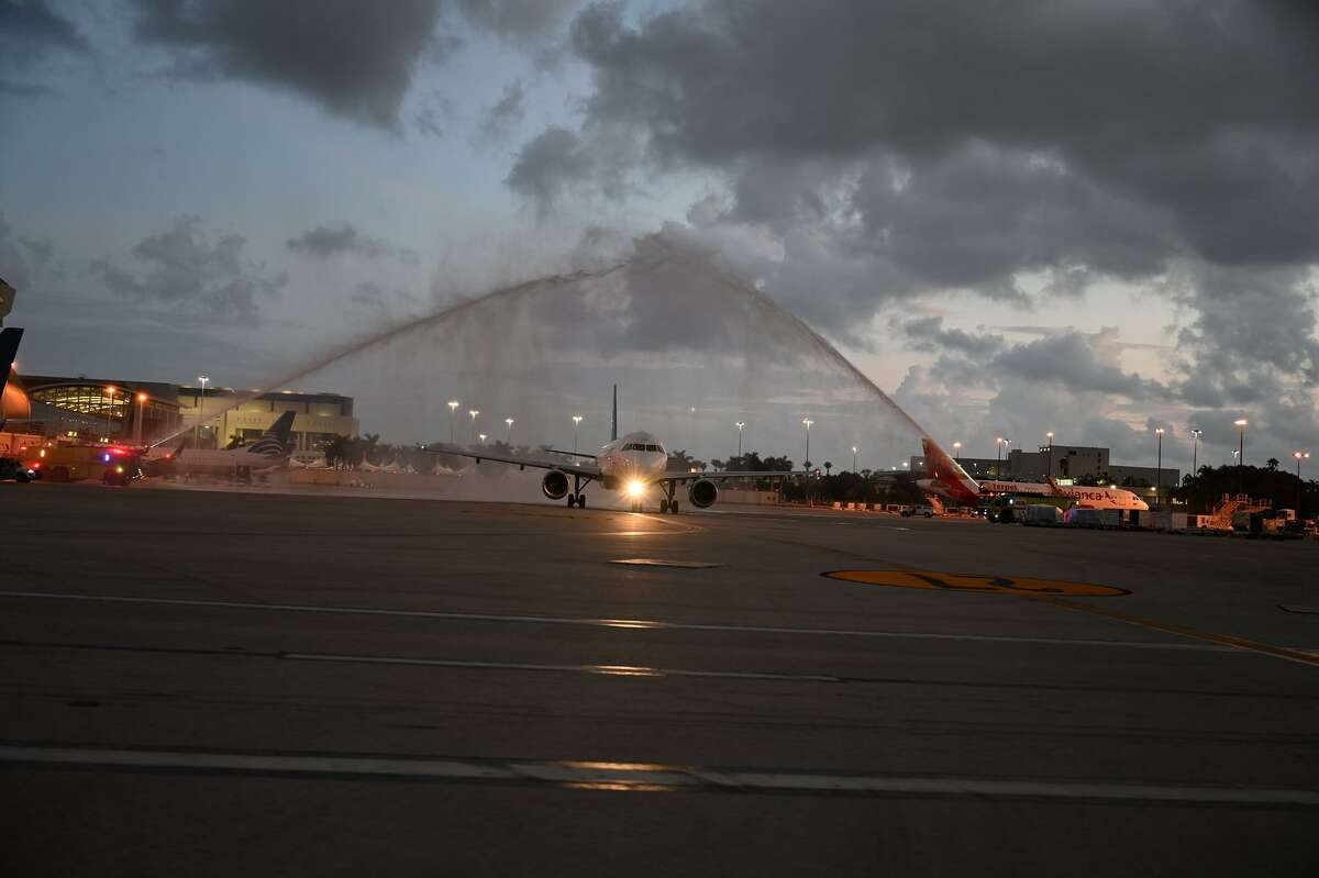 The plane for South Florida Honor Flight getting a water cannon salute as it leaves the Miami airport bound for Washington DC on Sept. 12.