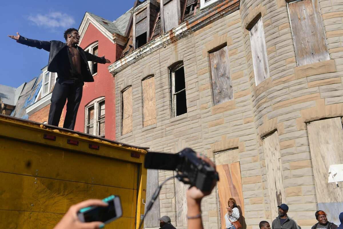 BALTIMORE, MD- APRIL 28: Dimitri Reeves regularly performs as a Michael Jackson impersonator. He entertained West Baltimore residents with many of the pop singers songs and he also performed the famous Beetles song Come Together as peaceful protesters marched through the neighborhood. Continued coverage of Baltimore after the death of Freddie Gray in Baltimore, Maryland on April 28, 2015. (Photo by Marvin Joseph/The Washington Post via Getty Images)