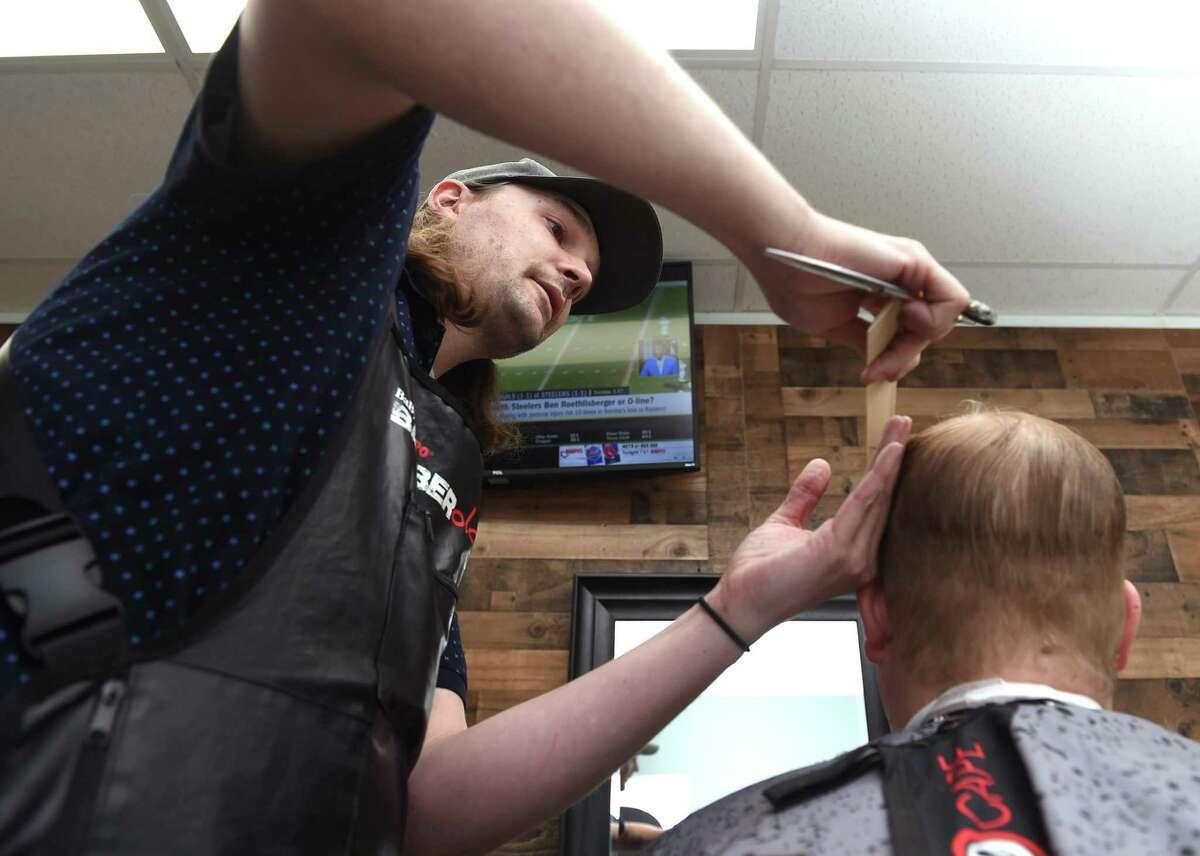 Matt Conklin cuts the hair of Andrew Anziano of Orange at Matt's Barber Shop on the Boston Post Road in Orange on September 22, 2021.