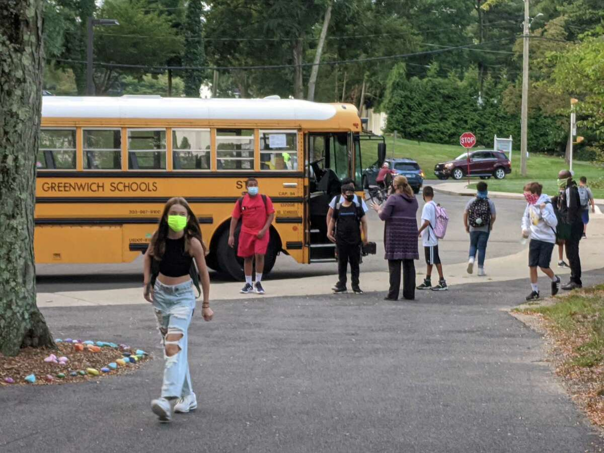 School buses ran mostly as scheduled on Monday despite the threat of walkouts by bus drivers not willing to comply with vaccination rules. Pictured is a scene in Greenwich earlier this month on the first day of school.