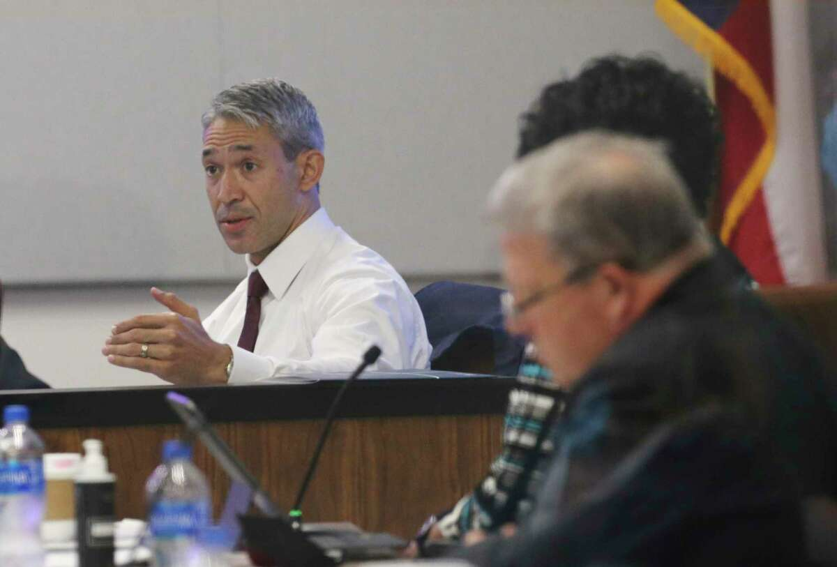 Mayor Ron Nirenberg (center) speaks as CPS Energy officials meet for the utility's monthly board meeting where a possible rate hike was discussed on Monday, Sept. 27, 2021. A small group of residents objecting to the increase voiced their issues outside of the CPS Energy headquarters before the meeting.