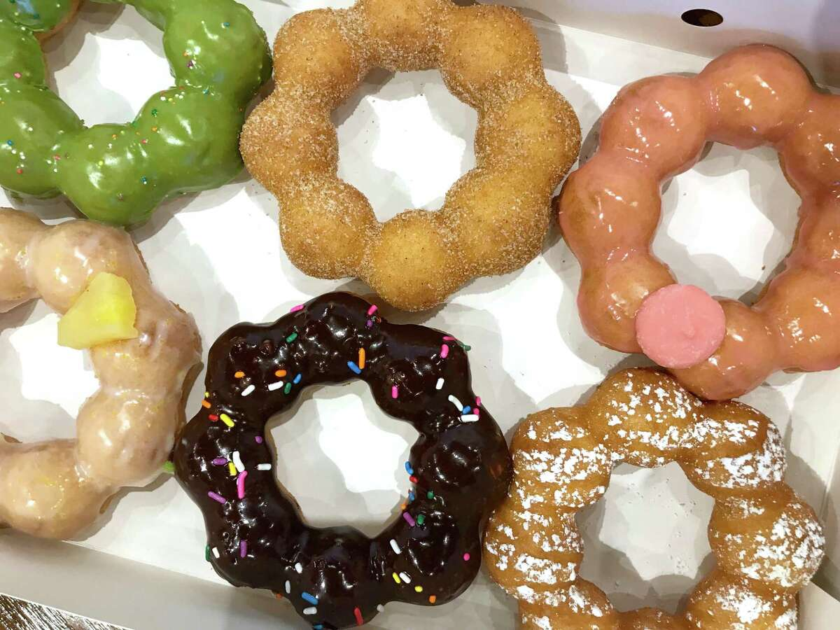 Matcha (clockwise from top left), churro, watermelon, caramel drizzle, chocolate and piña colada doughnuts from Mochinut.