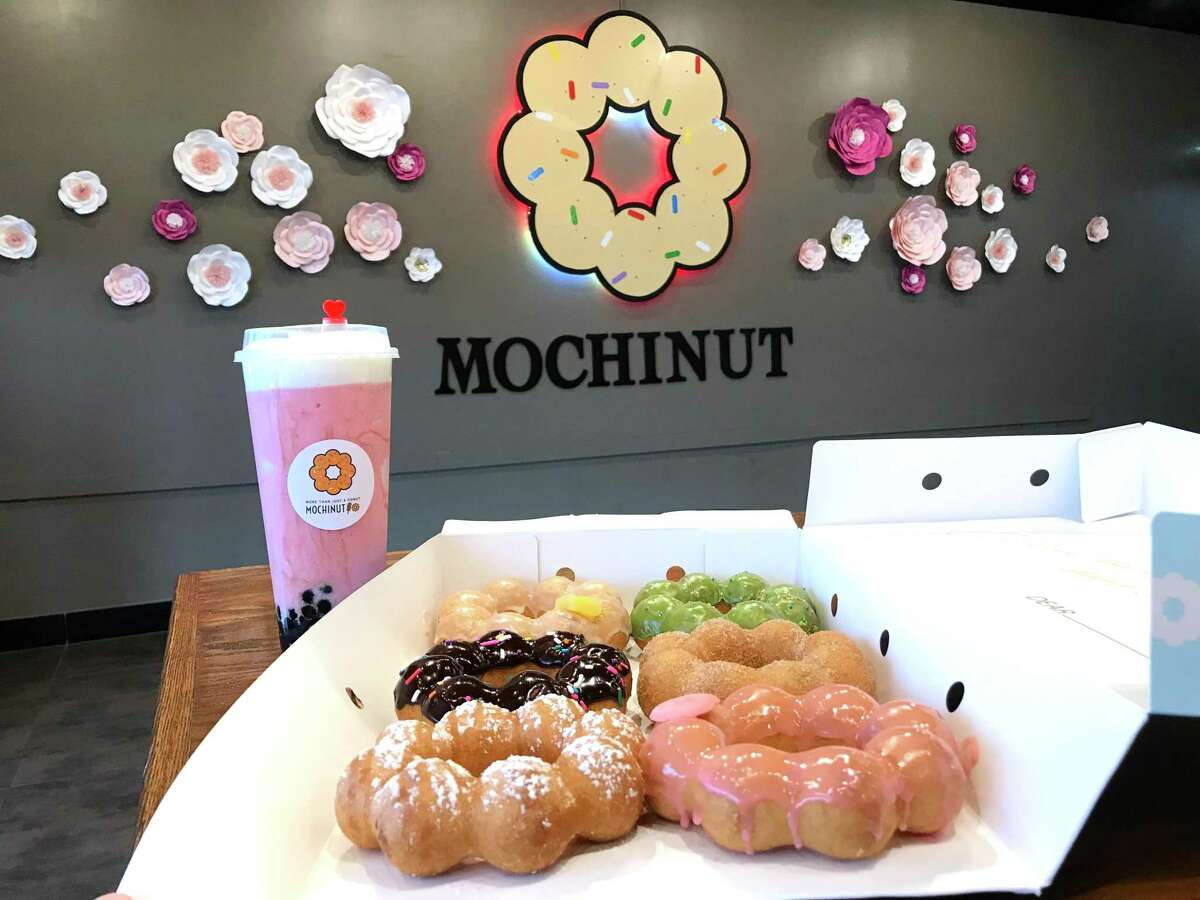A selection of doughnuts and a strawberry cheese smoothie from Mochinut