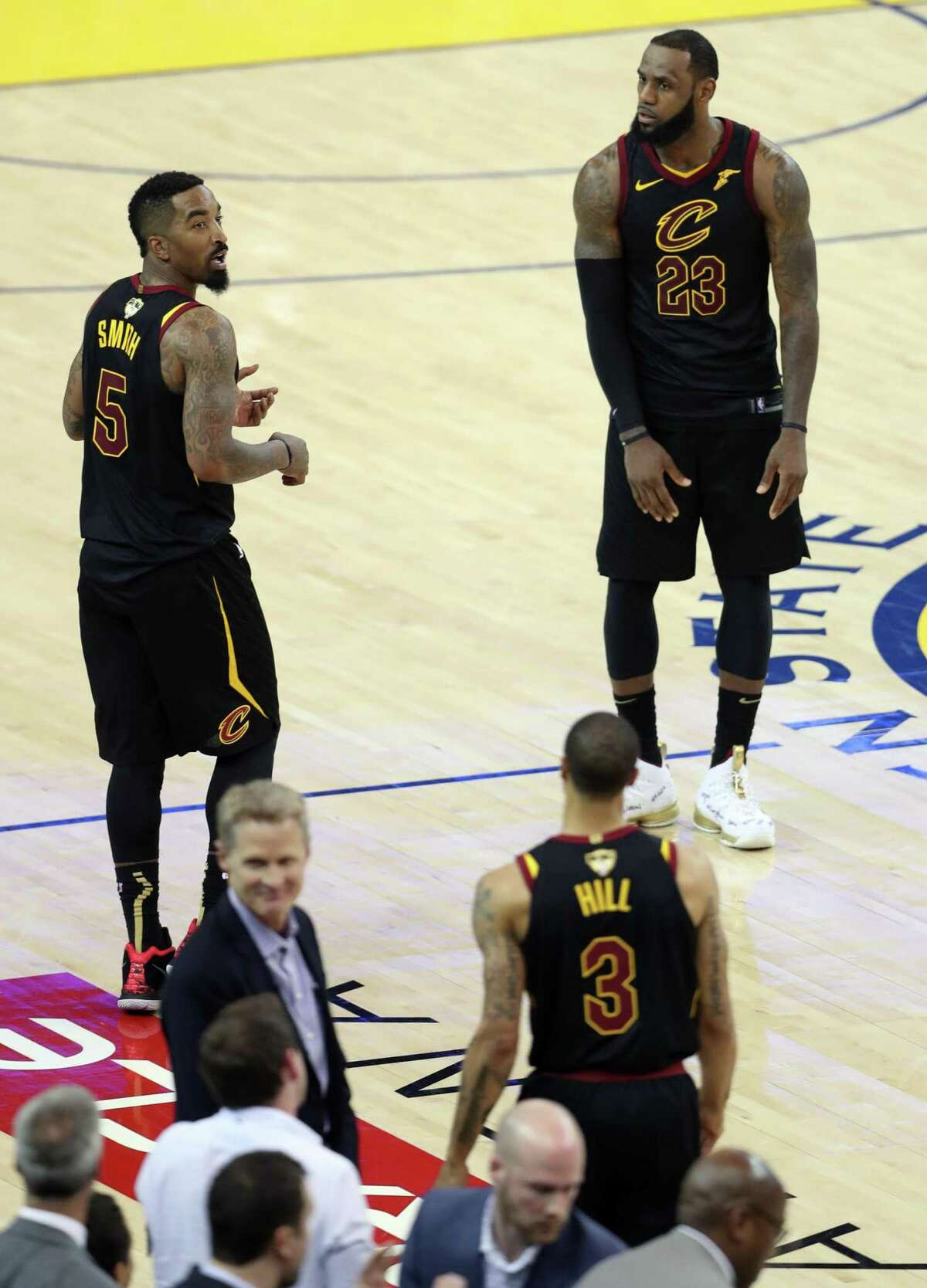 Cleveland Cavaliers' JR Smith and LeBron James react after Smith rebounded a missed free throw in final seconds but dribbled away from basket because he thought the Cavaliers had the lead during Golden State Warriors' 124-114 overtime win in Game 1 of the NBA Finals at Oracle Arena in Oakland, CA on Thursday, May 31, 2018.