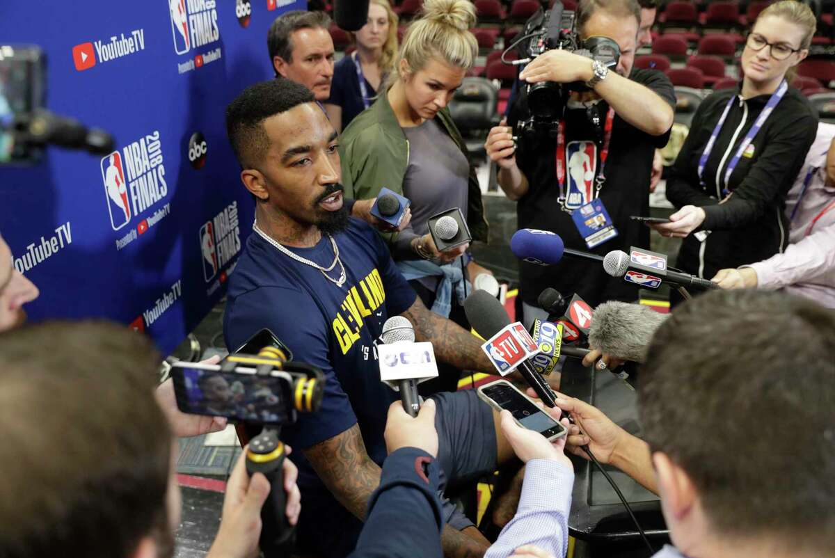 """FILE - In this June 7, 2018, file photo, Cleveland Cavaliers guard JR Smith (5) speaks during an press conference following the basketball team's practice during the NBA Finals, in Cleveland. Disgruntled Cavaliers forward J.R. Smith has gotten his wish. The Cavs announced Tuesday, Nov. 20, 2018, that Smith """"will no longer be with team as the organization works with JR and his representation regarding his future."""" (AP Photo/Michael Conroy, File)"""
